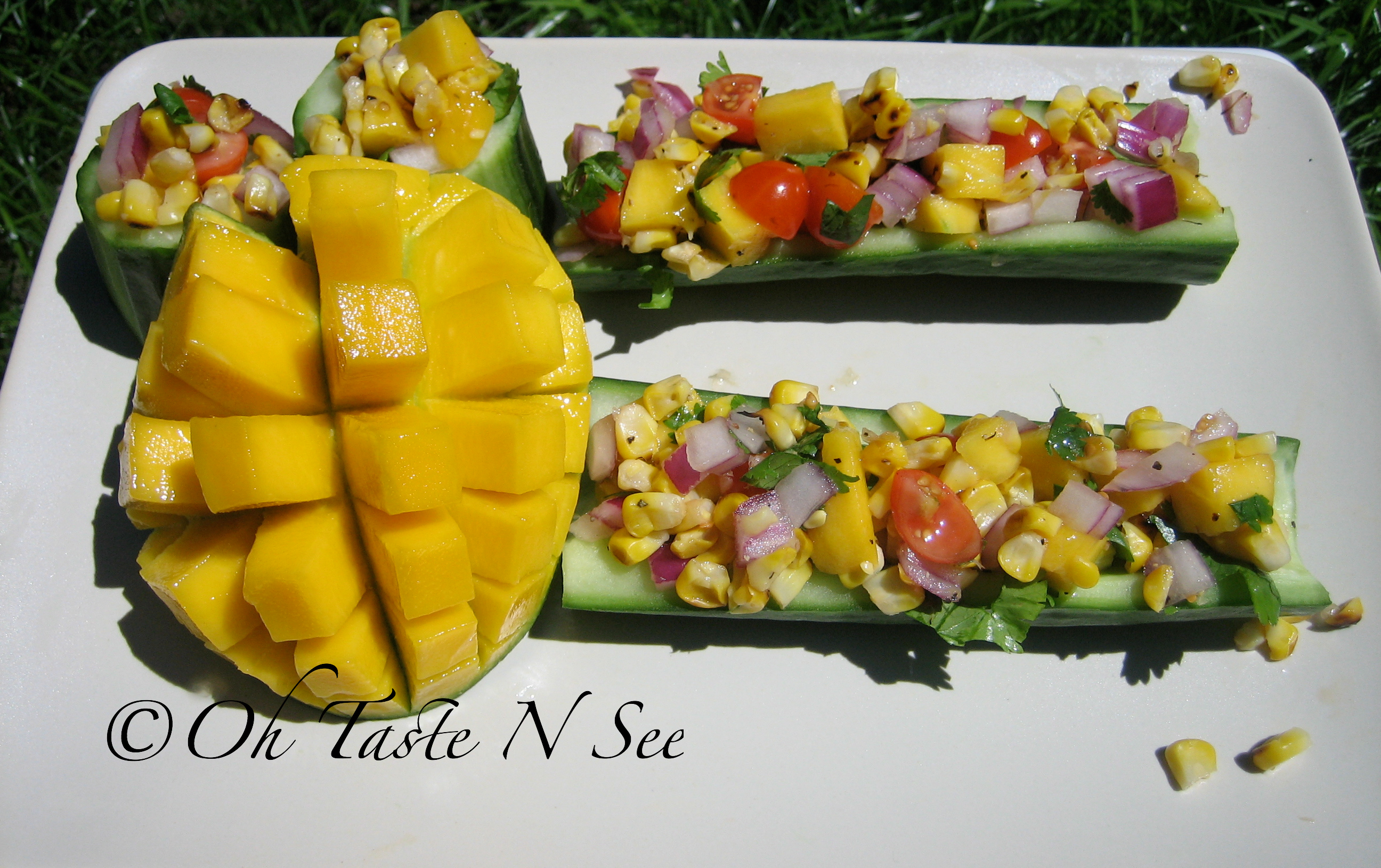 Grilled corn salad in cucumber boats/cups